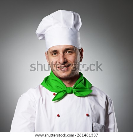 Male chef with thumb up portrait against grey background - stock photo