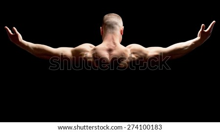 Male. Close up of sports man's muscular back isolated on black background - stock photo