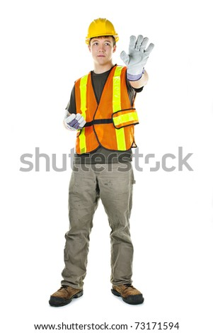Male construction worker directing with hand signals in vest and hard hat - stock photo