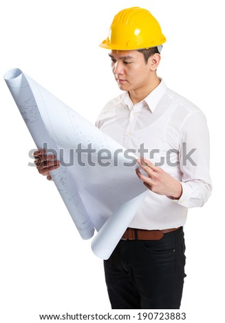 Male construction worker reading on blue print - stock photo