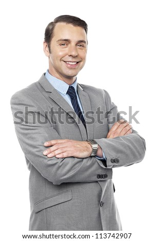 Male consultant smiling with his arms crossed isolated against white background - stock photo