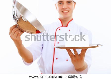 Male cook in uniform holding an empty tray - stock photo