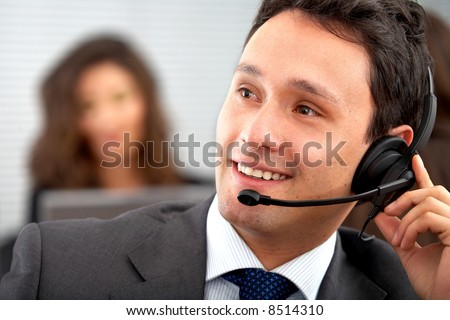 male customer service representative smiling in an office - stock photo
