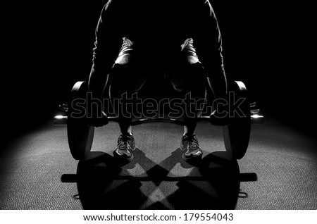 Male Deadlifting Position black and white - stock photo