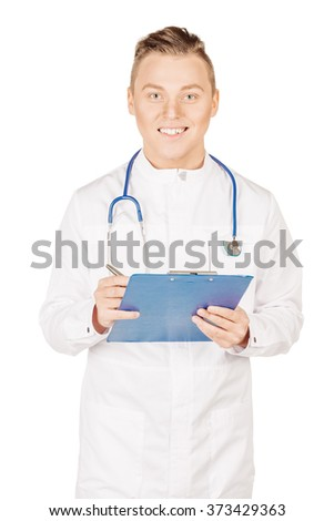 male doctor in white coat filling in prescription form .People and medicine concept. Image isolated on a white background. - stock photo