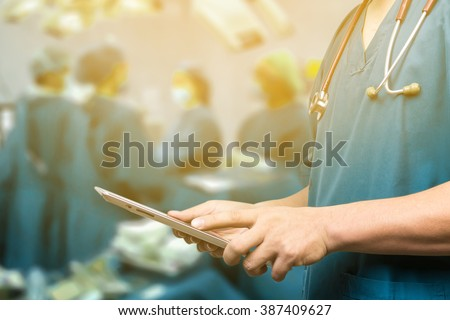 Male doctor,medical students or surgeon using digital tablet and laptop during the conference,Health Check with digital system support for patient,test results and patient registration,selective focus - stock photo