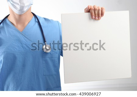 Male doctor showing clipboard with copy space for text. - stock photo