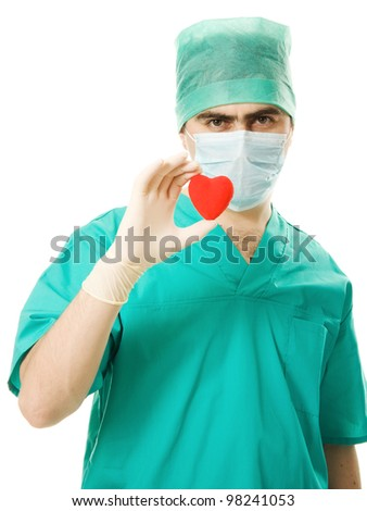 Male doctor with a heart in his hands on a white background. - stock photo