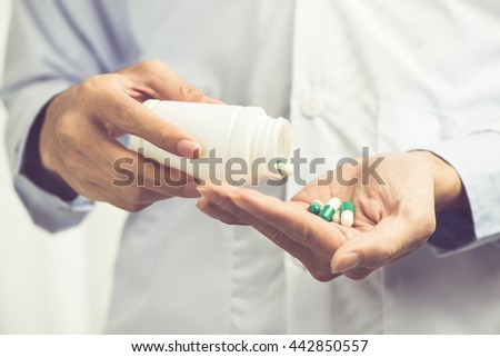 Male doctor With Medication. Focus on pills - stock photo