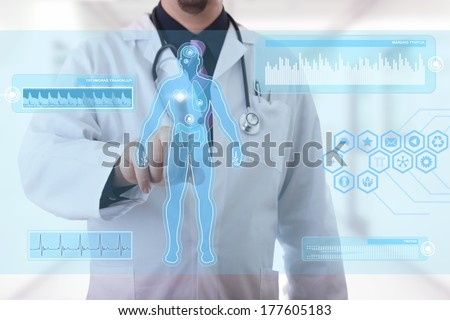 Male doctor working on a futuristic touchscreen display - stock photo