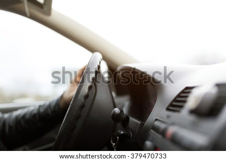 Male driving car close up driver hand selective focus - stock photo