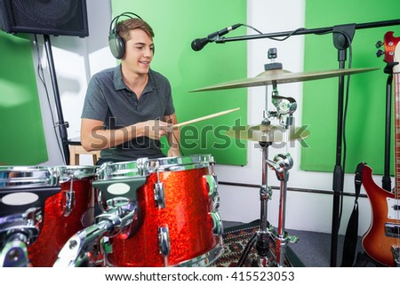 Male Drummer Playing Cymbal In Recording Studio - stock photo