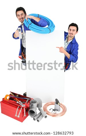 male duo of plumbers with tools - stock photo