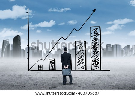 Male employee holding a briefcase and look at a growing chart with upward arrow - stock photo