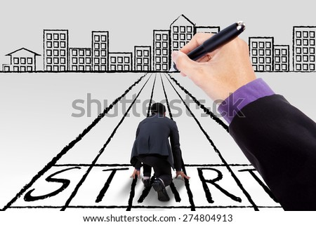 Male entrepreneur kneeling on a start line with a hand guiding him to the city - stock photo