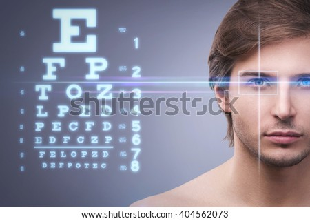 Male face and eye chart. Eyesight concept - stock photo