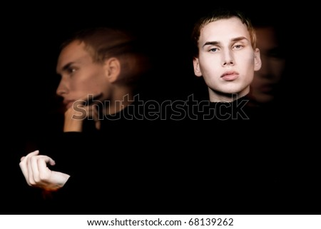 male face in motion over black - stock photo