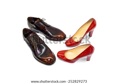Male&female shoes on white background. - stock photo