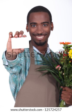 Male florist with business card - stock photo