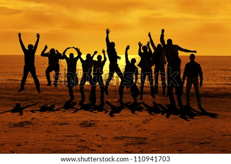 Male friends are having fun at summer and jumping up on the sunset near the sea - stock photo