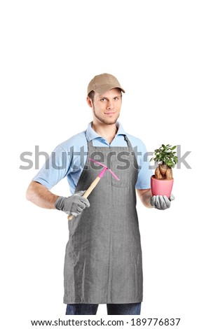 Male gardener holding a mattock and a plant isolated on white background - stock photo