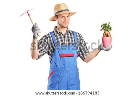 Male gardener holding a plant isolated on white background - stock photo