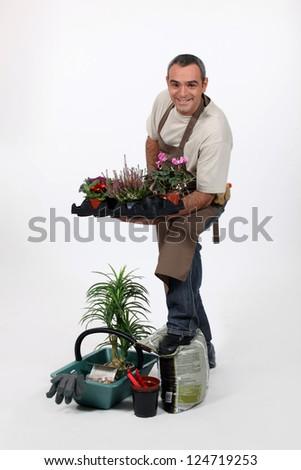Male gardener in studio - stock photo