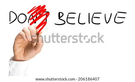 Male hand changing a Don't believe sign into a Do believe sign. Conceptual of faith, hope and belief. - stock photo