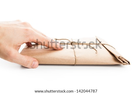 Male hand delivers envelope tied with a rope isolated on white background - stock photo