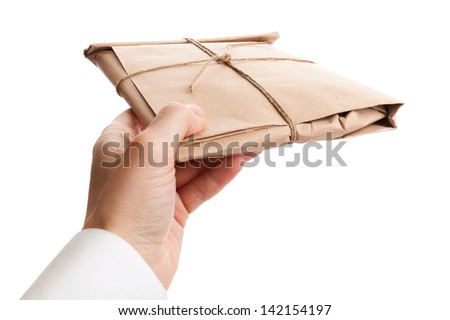 Male hand delivers full envelope tied with a rope isolated on white background - stock photo