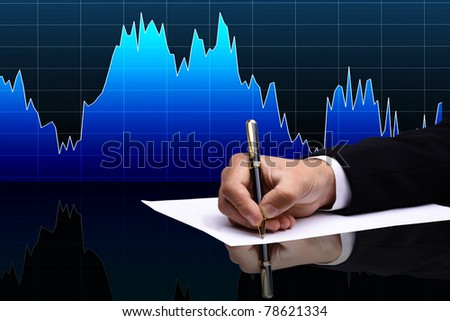 Male hand drawing a chart - stock photo