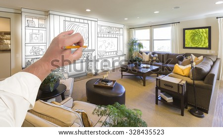 Male Hand Drawing Entertainment Center Unit Over Photo of Beautiful Home Interior. - stock photo