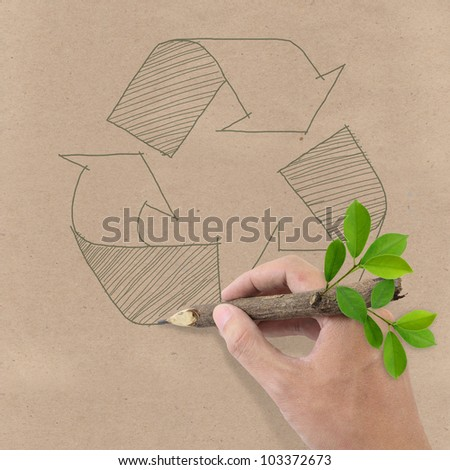 Male hand drawing recycle symbol on Brown Recycled Paper. - stock photo