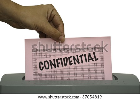 Male hand, feeding a pink piece of paper with the word confidential and random numbers into a shredder. Saved including clipping path. - stock photo