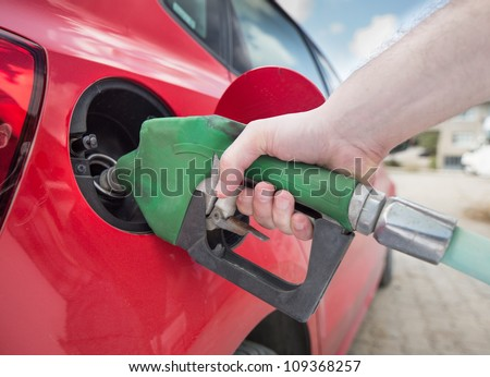 Male hand filling gas close up - stock photo