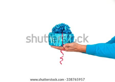 Male hand giving and gift box isolated on white background - stock photo