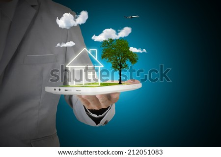 Male Hand hold digital tablet present Nature house or home - stock photo