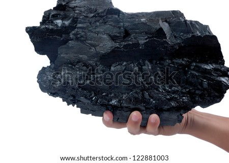 male hand holding a big lump of coal isolated on white background - stock photo