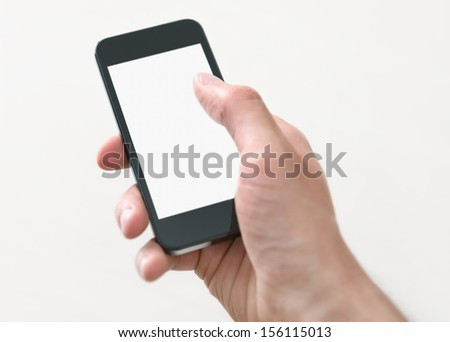 Male hand holding and touching on mobile smartphone with blank screen. Isolated on white background. - stock photo