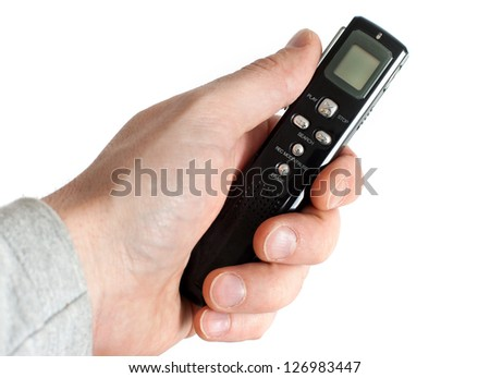Male hand holding Audio Recorder using for documenting sound - stock photo
