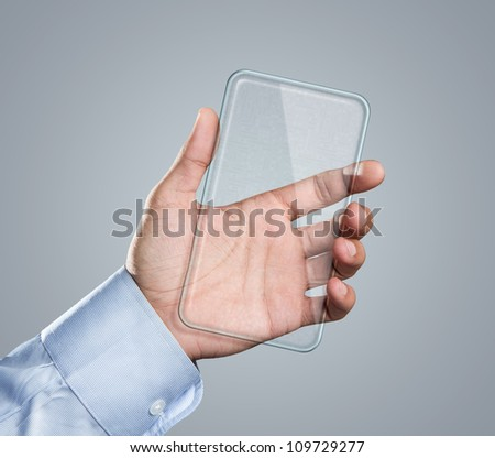 Male hand holding blank futuristic transparent mobile, smart phone with copy space - stock photo