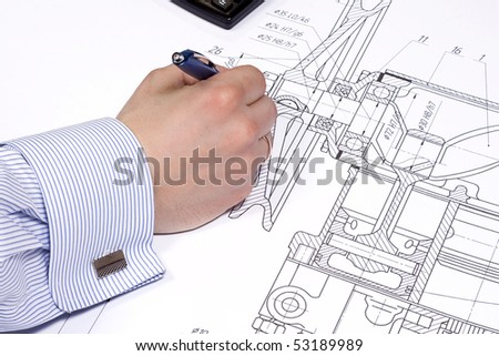 male hand holding blue pen - stock photo
