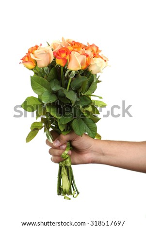 Male hand holding bouquet of orange roses on white background - stock photo