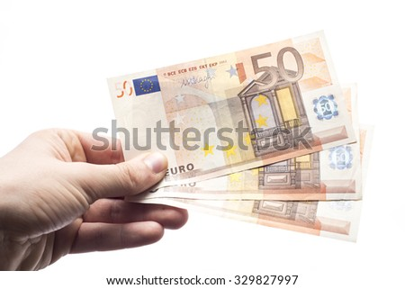 Male hand holding cash isolated on white background - stock photo
