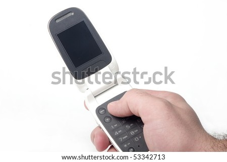 Male hand holding folding style cell phone. Included clipping path of display. - stock photo