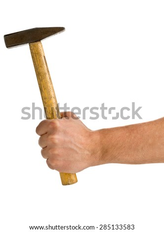 Male hand holding hammer isolated on white background - stock photo