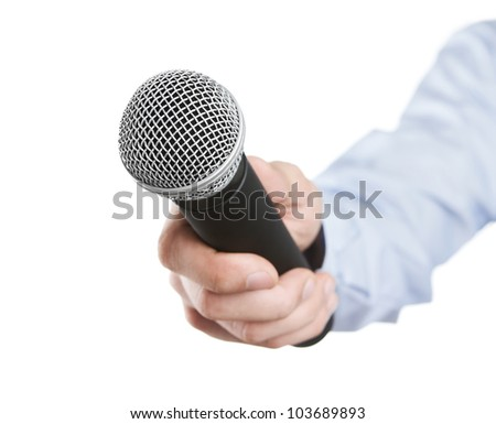 Male hand holding microphone for the interview - stock photo