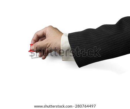Male hand holding red pushpin tacked on white background - stock photo