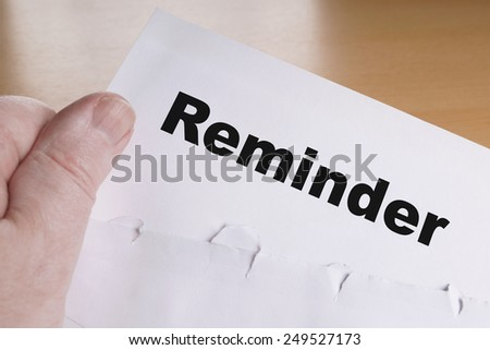 male hand holding reminder letter - stock photo
