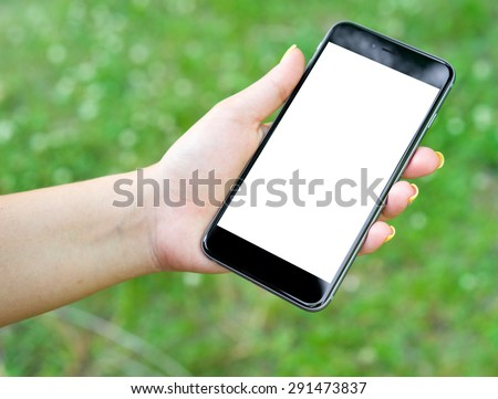 Male hand holding the phone with isolated screen - stock photo